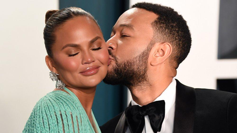 John Legend kissing Chrissy Teigen on the cheek