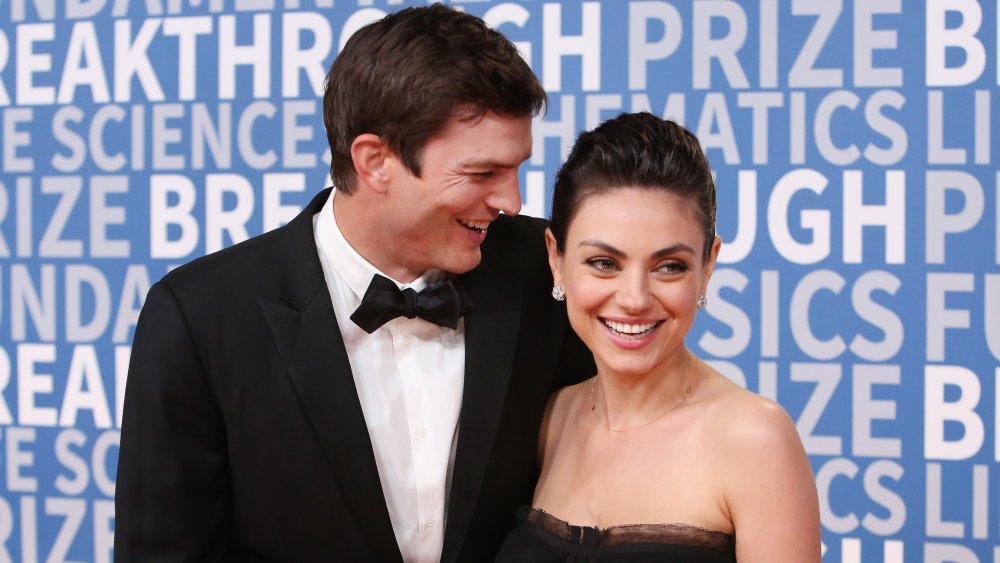 Ashton Kutcher and Mila Kunis laughing on the red carpet