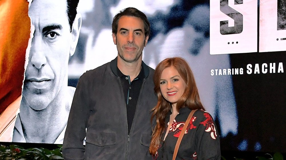 Sacha Baron Cohen with arm around Isla Fisher
