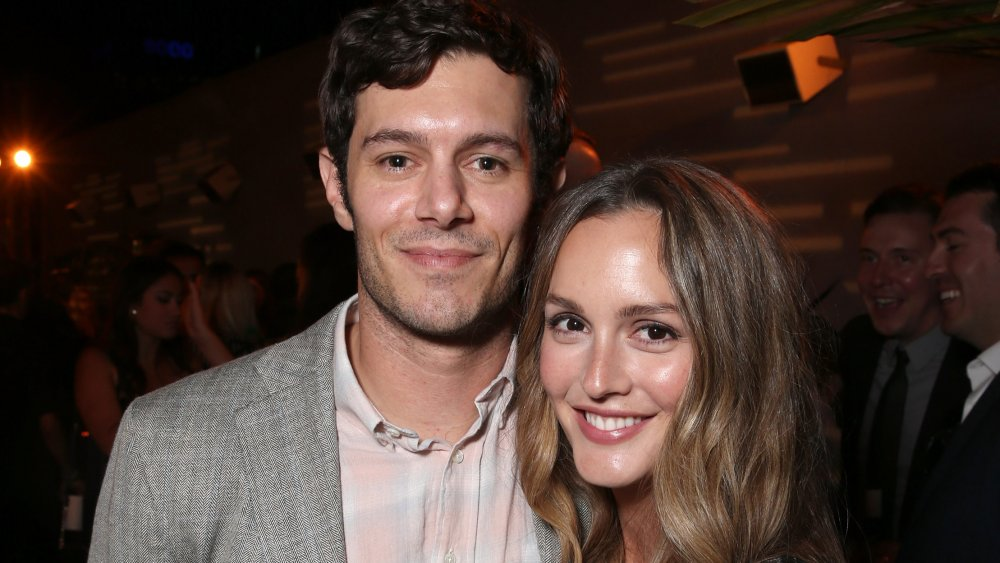 Leighton Meester and Adam Brody grinning