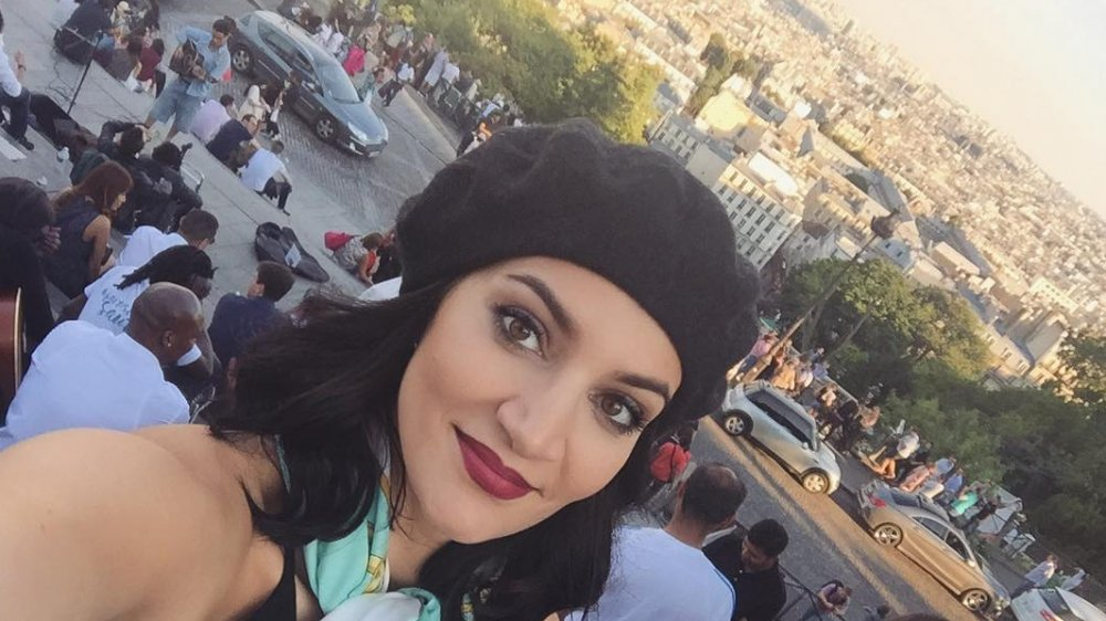 Sophie Brussaux takes a selfie in a beret