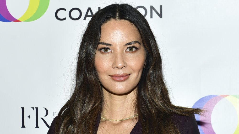 Olivia Munn smiling at promotional event
