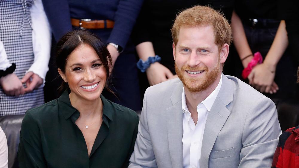 Prince Harry et Meghan Markle souriant