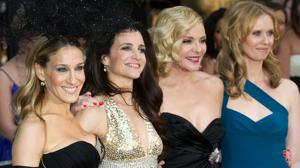 Sarah Jessica Parker, Kristin Davis, Kim Cattrall, Cynthia Nixon souriant à l'événement