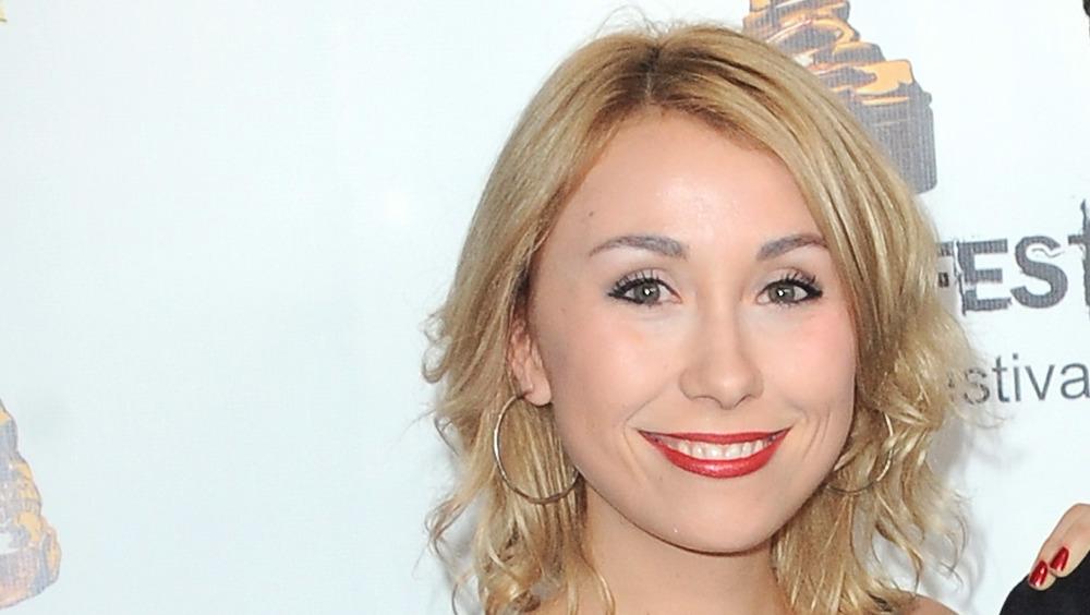 Caitlin Reilly sourit lors d'un événement