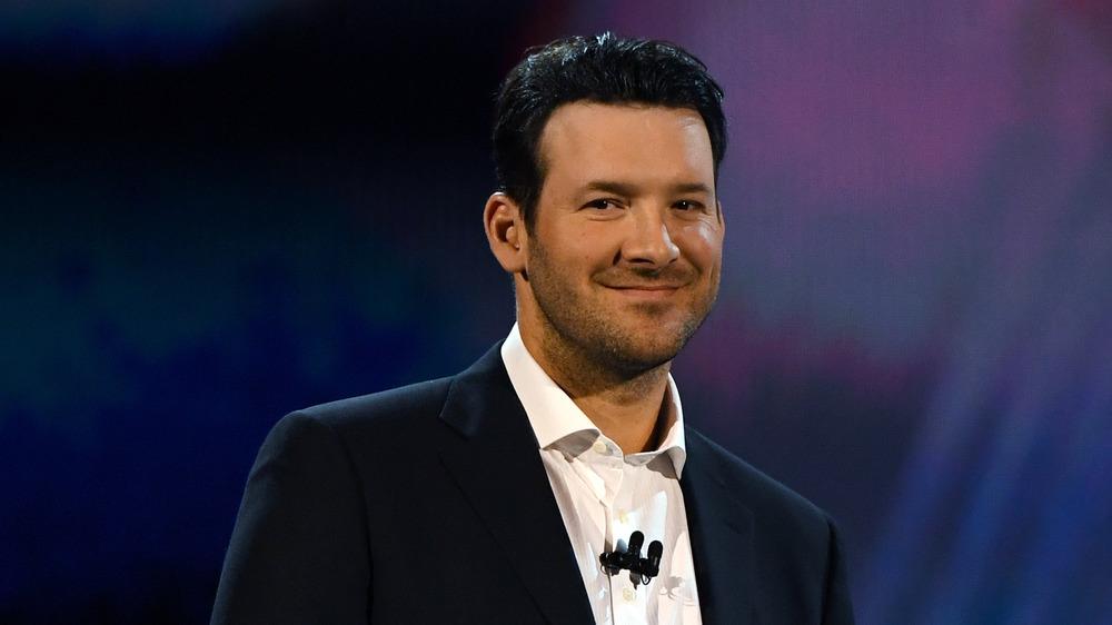 Tony Romo souriant lors d'un événement