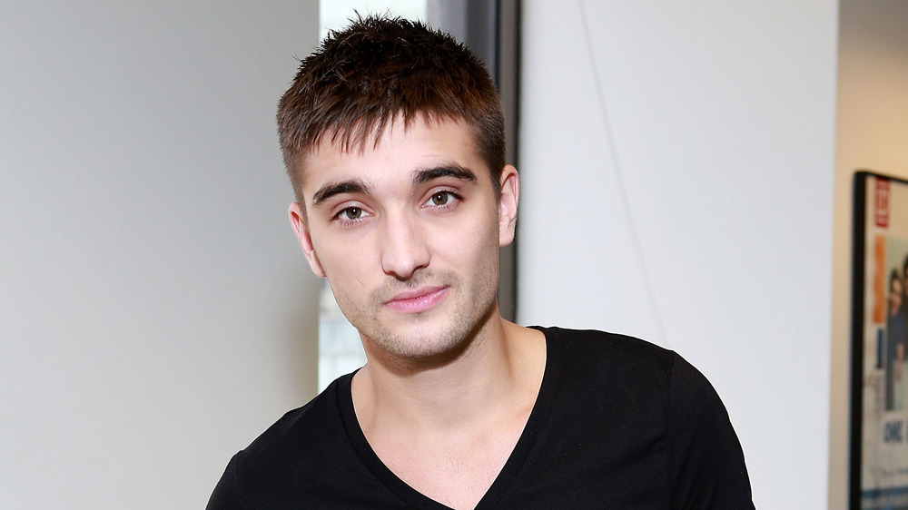 Tom Parker souriant