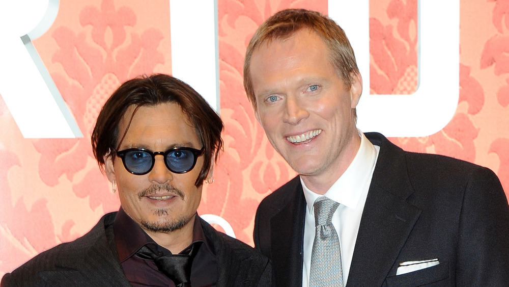 Johnny Depp et Paul Bettany souriant