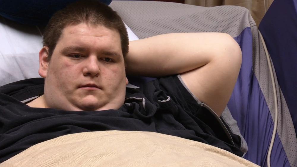 Sean Milliken couché dans son lit