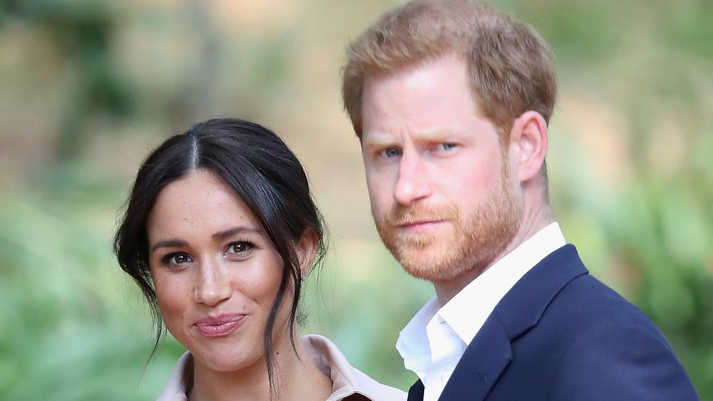Meghan Markle et le prince Harry regardant