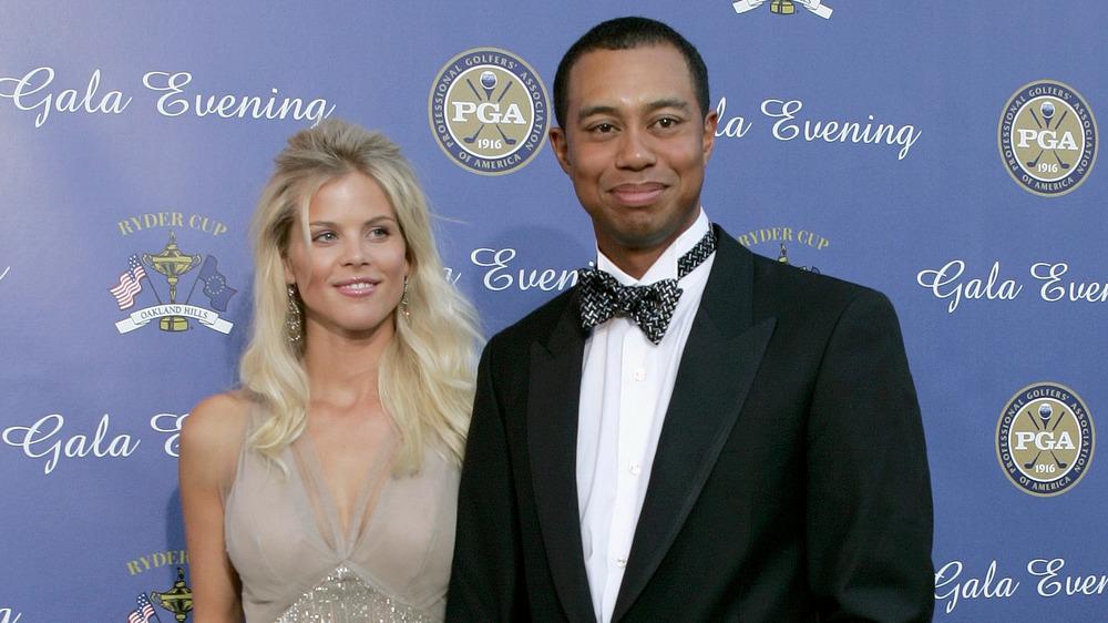 Elin Nordegren et Tiger Woods souriant