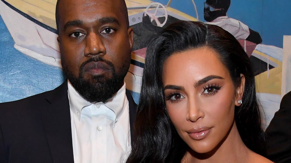 Kanye West, Kim Kardashian souriant